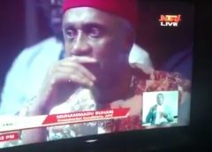 Amaechi's Look As Buhari Mumbles Over A Question At Town Hall Meeting